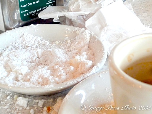 Only an empty plate and a pile of sugar remains after a trip to Cafe du Monde