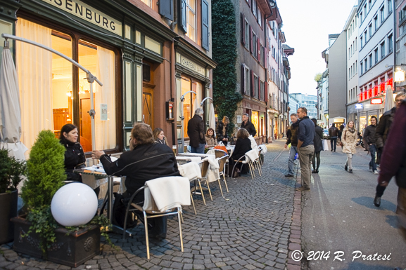 People enjoy the outdoor cafés, even in the cooler temperatures