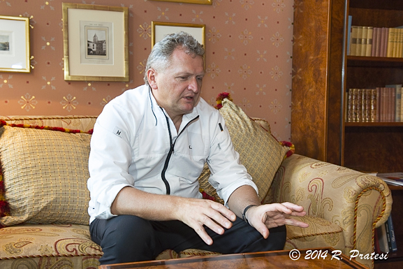Chef Peter Knogl in the library at Grand Hotel Les Trois Rois