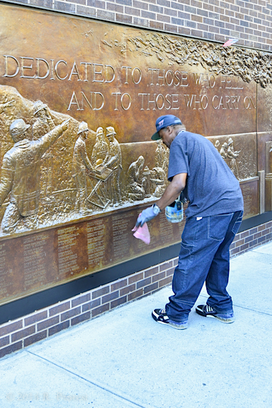 This man polishes this plaque all day every day while talking about 9/11