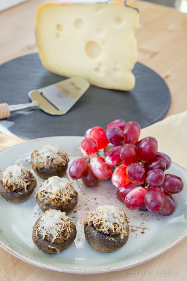Serve the stuffed mushrooms with an assortment of cheeses and fresh fruit