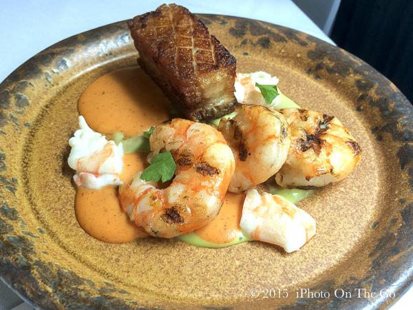 Grilled Shrimp with sous-vide pork belly, romesco, leek purée, pickled shrimp