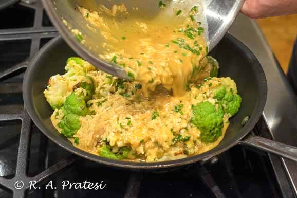 Evenly incorporate the custard mixture into the broccoflower so the frittata cooks evenly