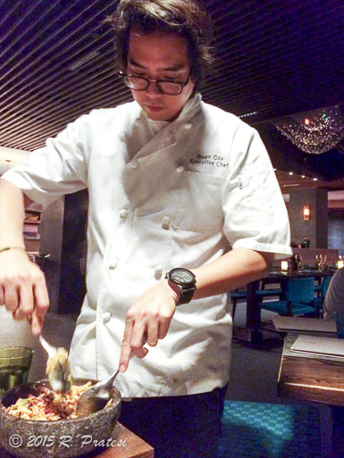 Preparing one of his specialties tableside, Chaufa Aeropuerto