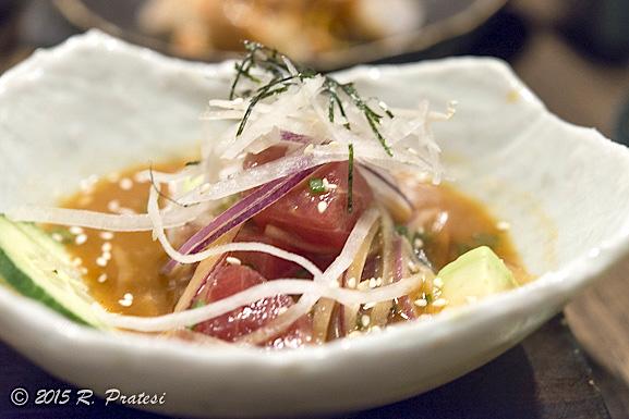 Nikkei cebiche - tuna, red onions, nori, avocado, daikon, cucumber, nikkei tamarind leche de tigre