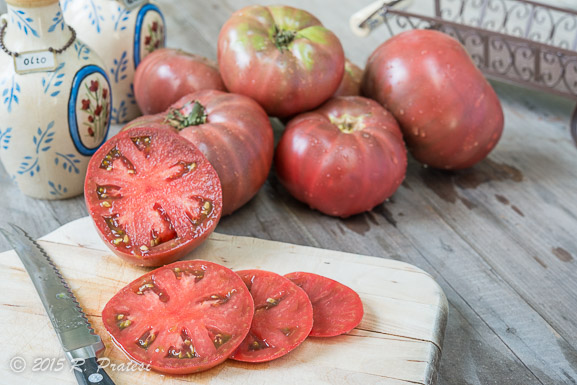 "The Cherokee Purple Tomato known as a ""black"" is deep reddish purple in color"