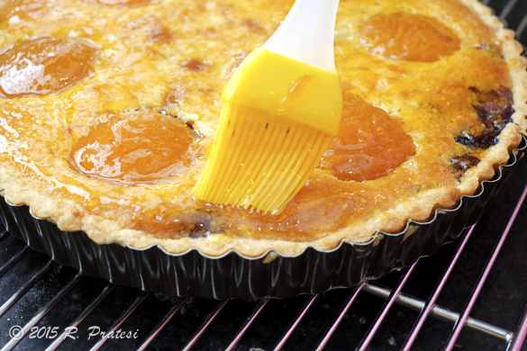 With a pastry brush, laze the warm tart with the apricot glaze