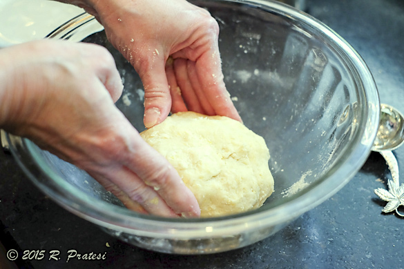 Shape the dough into a ball and then flatten slightly
