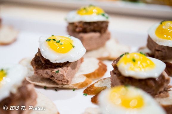 Quail pâté on pretzel crostini, bacon-raisin jam, fried quail egg, and chive