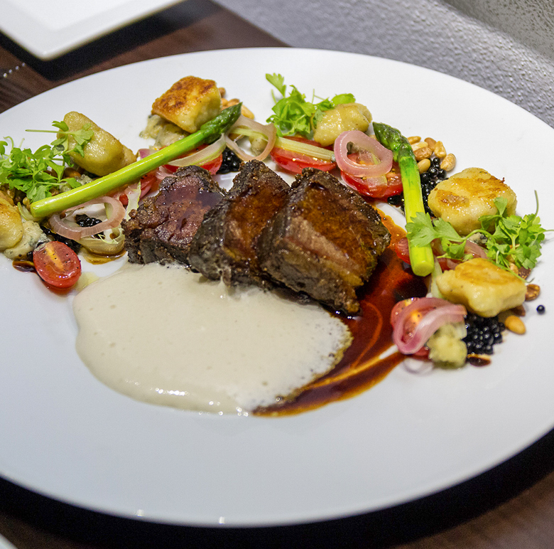 "* Signature Beef Short rib, 72 hour sous vide, pine nut, heirloom tomato, basil, potato gnocchi, Point Reyes ""Bay Blue"" cheese"